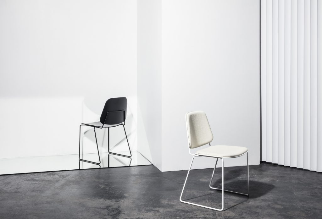 the skudo chairs designed by gam fratesi is a modern re interpretation of the classic 50 s double shell chairy